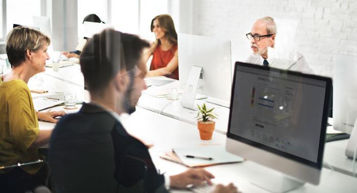 Deal Registration Benefits, team working on desktops