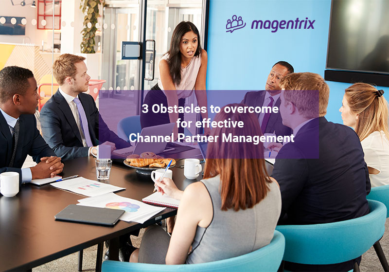 People sitting at table discussing the 3 obstacles they need to overcome for effective channel partner management
