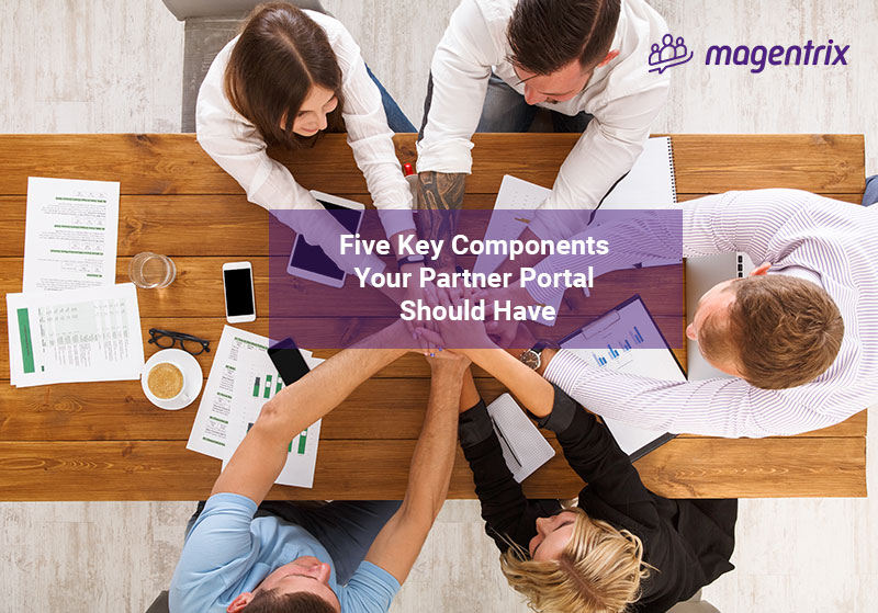 Channel Managers at table discussing the 5 key components a partner portal should have